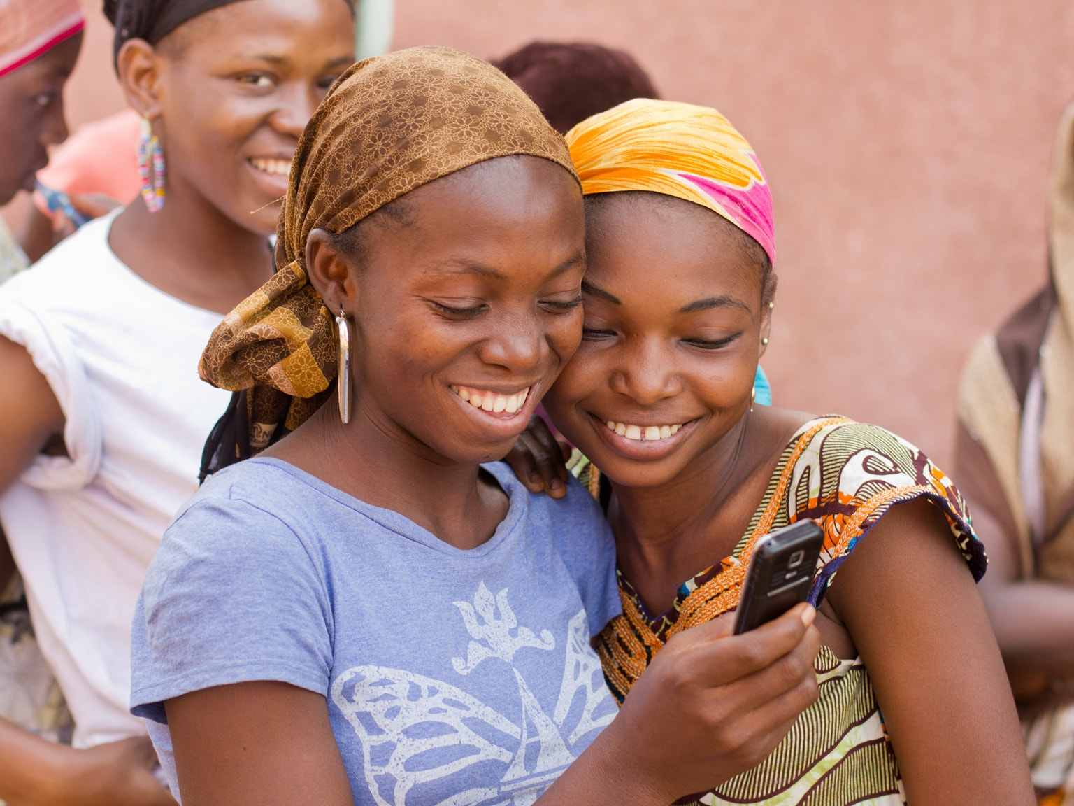 Happy women after receiving a bulk sms message